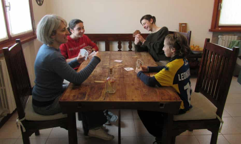 The Jones family, Francesca, Emma, Benedetta and Leonardo, play cards at home during the lockdown.