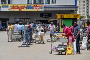 People buy groceries at a supermarket in Bangalore