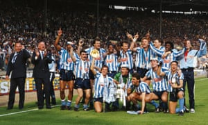 The Coventry City squad celebrate with the trophy .