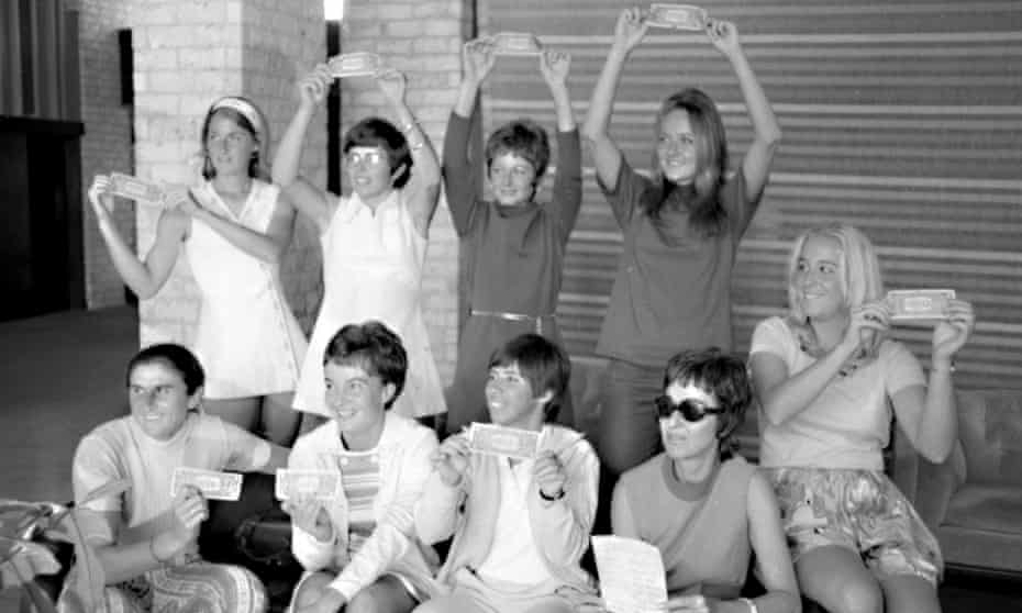 The 'Original 9' women's players who decided to break away from the male game show off their one-dollar contracts 50 years ago this week.