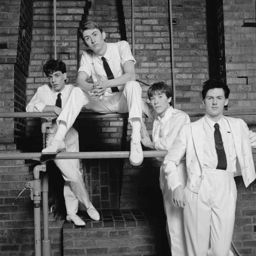 Mark Hollis, second from left, with, from left, the keyboard player Simon Brenner, drummer Lee Harris and bassist Paul Webb, in a 1982 publicity shot for Talk Talk - Hollis was said to hate the way EMI packaged the band in white suits and black ties.