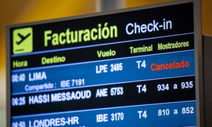 A departure board in Madrid, Spain, announces a Lima flight cancelled as Peru closed its border.