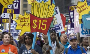 Minimum-wage campaigners take part in a 'Fight for $15' march and rally in New York City.