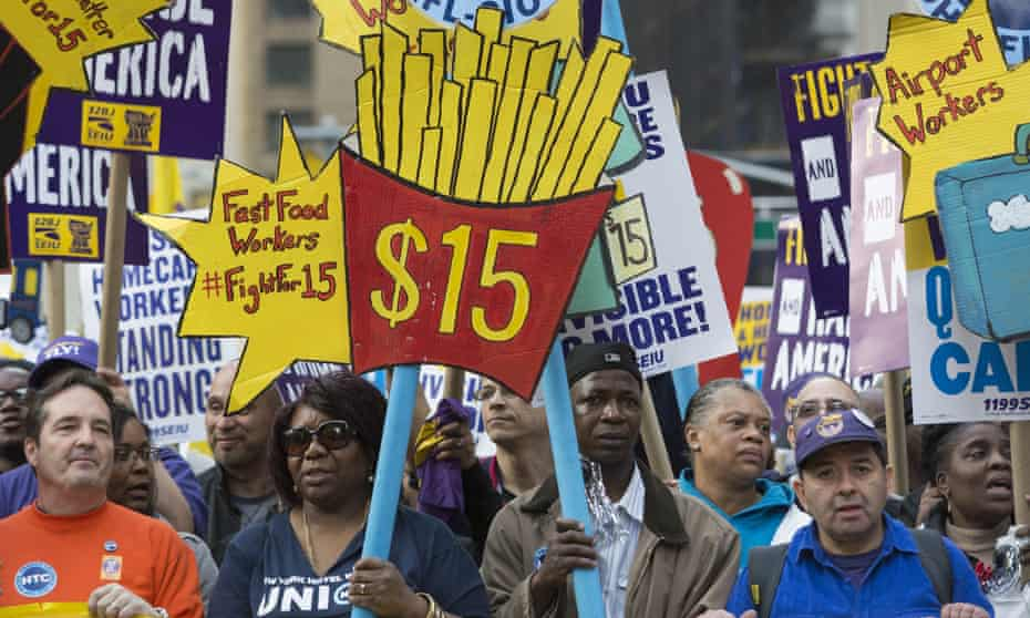 New York City joins fight for $15 minimum 'living wage'15 Apr 2015, New York City, New York State, USA --- New York, United States. 15th April 2015 -- Activists hold placards at New York City's 'Fight for $15' march and rally. -- New York City workers took to the streets as they marched from Columbus Circle to Times Square demanding that the minimum wage be increased to $US15 per hour. --- Image by Angel Zayas/Demotix/Corbis