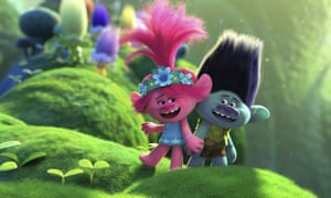 Two of the animated characters from Trolls World Tour in a plant-filled landscape