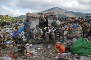 Men and boys at El Crematorio, the biggest dump on the outskirts of Tegucigalpa in Honduras, take a break from collecting plastic and cardboard to resell