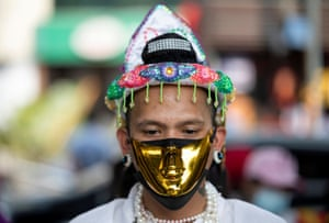 Yangon, Myanmar: A demonstrator wears a golden face mask during a protest against the military coup