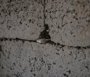 A toothbrush left in a crack in the wall