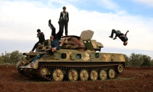 Muhannad al-Kadiri (R),18, and Ibrahim Eid, 16, demonstrate their Parkour skills over a military vehicle in the rebel-held city of Inkhil, west of Deraa, Syria, February 4, 2017.