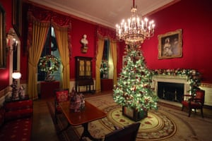A small decorated Christmas Tree stands in the Red Room at the White House.