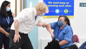 Orpington, UK. Boris Johnson greets nurse Michelle Bradford during a visit to a coronavirus vaccination centre at the Health and Wellbeing centre