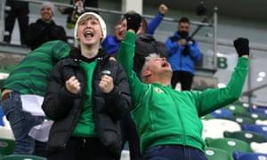Northern Ireland fans celebrate after Slovakia's Milan Skriniar scores an own goal.