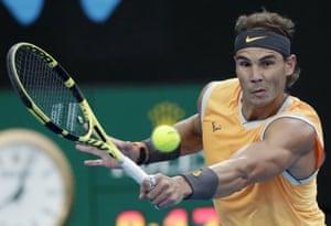Nadal hits a backhand return.