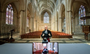 The Rev Michael Smith, York Minster's canon pastor, rehearses a digital Evensong service inside the cathedral.