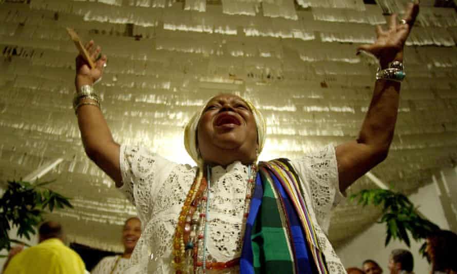 Candomble priestess Mae Beata de Iemenja invokes Ossae, the Yoruban god of medicine and herbs, during a Candomble ceremony in Nova Iguacu, Brazil.
