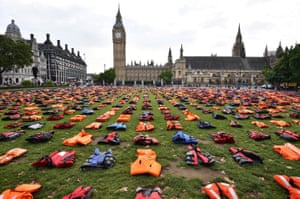 Lifejackets that have been used by refugees to cross the sea to Europe are laid out in Parliament Square in London on 19 September