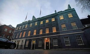 The Union flags above Downing Street have been lowered to half mast to honour Captain Sir Tom Moore.
