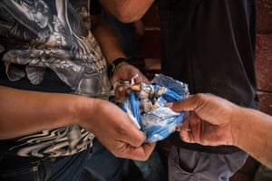 Drugs and gang activity go hand in hand here. The Western Cape has the highest rate of drug related arrests in the country (a recorded 88,000 incidents last year), with Cape Town being the worst offending city in the country. Gang and Task Team officers display marijuana and methamphetamine seized from a suspected drug dealer in Lavender Hill, Cape Town