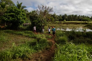 In Laguna province, south of Manila, students Jester Rafon, 20, Rosemine Gonzaga, 19, Jenebyl Cipres, 19, and Almer Acuno, 21, trek up a mountain to get internet access