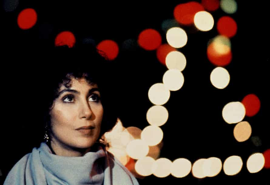Cher at night against lights