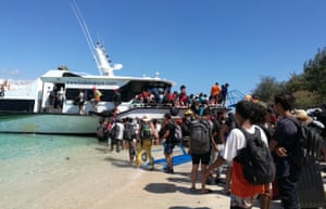 Visitors evacuate from Gili Trawangan near Lombok Island in Central Indonesia.