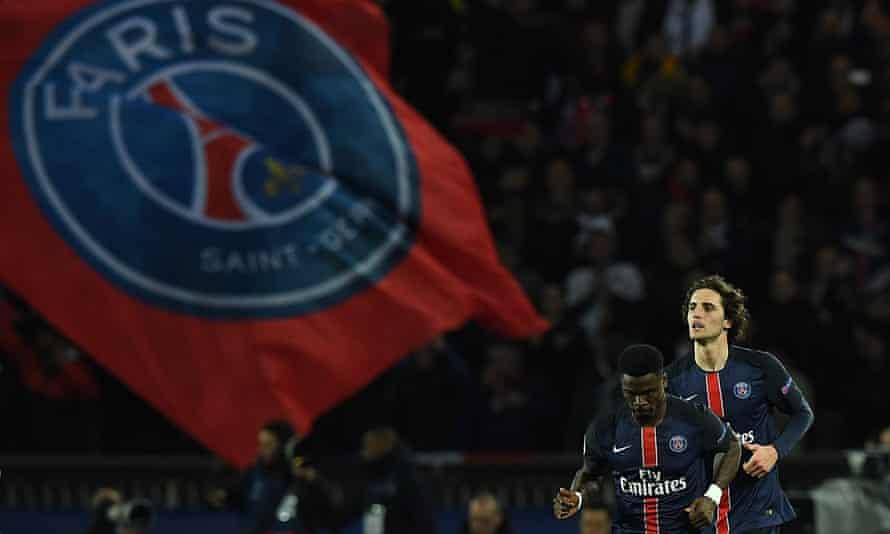 Paris Saint-Germain's Adrien Rabiot and Serge Aurier celebrate