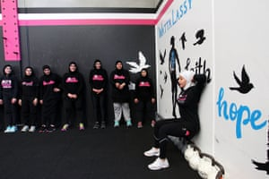 Dalal Karra-Hassan shows the class how to do a wall squat