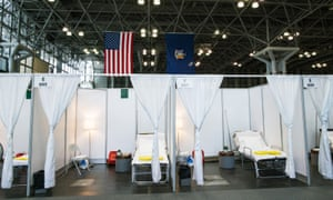 Hospital bed booths are set up at the Jacob K. Javits Convention Center in New York City.