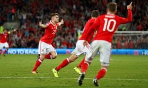 Wales' 17 year old debutant Ben Woodburn celebrates after opening the scoring.