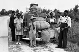 A group of migrant workers from Florida stop in Sawboro, North Carolina, on their way to Cranberry, New Jersey, to pick potatoes in July 1940.