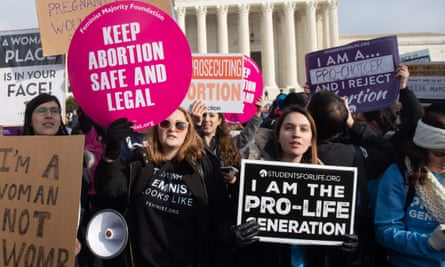 Pro-choice and anti-abortion activists outside the supreme court in Washington DC on 18 January.