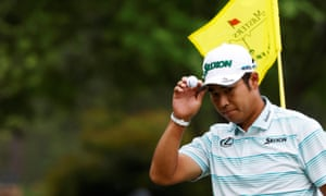 Hideki Matsuyama acknowledges the crowd after holing an eagle putt on the 15th green.