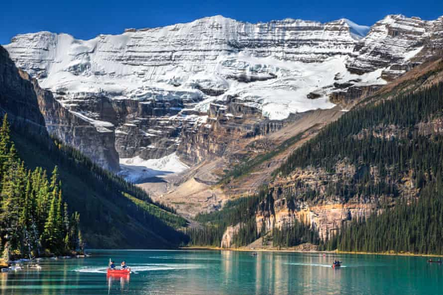 Tourists canoeing at Lake Louise in Banff.
