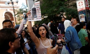 Demonstrators shout outside Kensington town hall, during a protest after the fire that destroyed Grenfell Tower.