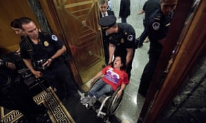 Woman in wheelchair removed from Senate finance committee hearing