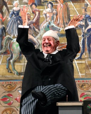Dario Fo impersonating Silvio Berlusconi during a preview of his satirical show L'Anomalo Bicefalo in Bagnacavallo, northern Italy, 2003.