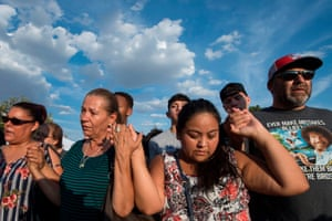 El Pasoans pray at a makeshift memorial for victims of Walmart shooting that left a total of 22 people dead.