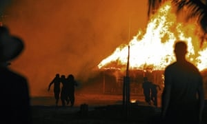 Huts are set alight for the climactic moment of First They Killed My Father.