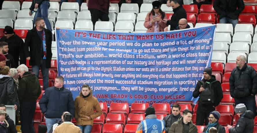 West Ham fans display a banner at Liverpool on Monday.