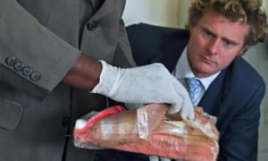 Jack Marrian watches as cocaine is presented as evidence at the police HQ in Nairobi, 2016.