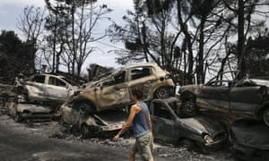 A stack of burnt cars piled up in Mati, the village worst hit by deadly wildfires in Greece