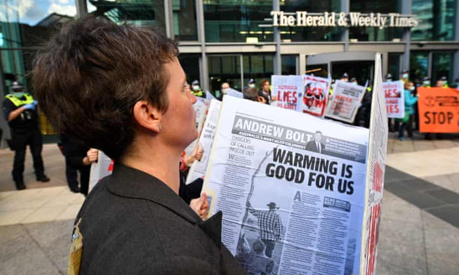 An Extinction Rebellion environmental protest against Rupert Murdoch and News Corp in Melbourne, Australia, 25 March 2021