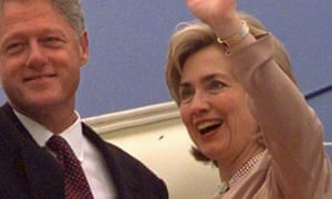 Hillary Clinton and her husband wave from Air Force One at the Beijing airport in 1998.