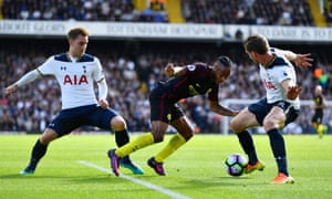 Christian Eriksen, left, and Jan Vertonghen deny Raheem Sterling the opportunity to turn during Tottenham Hotspur's fine victory over Manchester City.