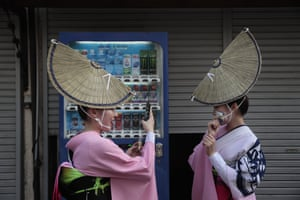 Kōenji, Tokyo: Two young dancers take pictures while waiting for the start of the Kōenji Awa-Odori dance festival