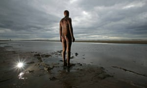 One of the figures in Antony Gormley's Another Place installation