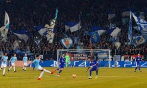 Schalke fans cheer on their back