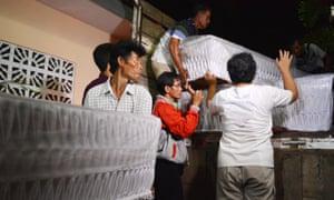 Undertakers in Central Java prepare coffins for death row inmates, including Australians Andrew Chan and Myuran Sukumaran. Nine coffins were prepared in total.