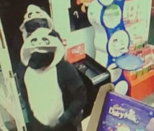 Image tweeted by Lincolnshire police ‏showing CCTV of suspects dressed in panda onesies