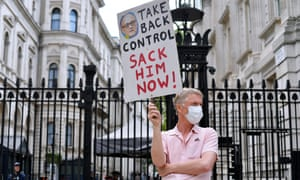 'Take back control. Sack him now!' is the message from one protester outside Downing Street on 27 May 2020.